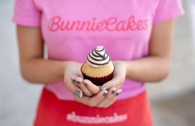 bunniecakes employee holding cupcake